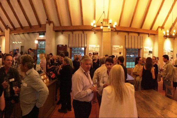 100 Members mingle in the Wine Room